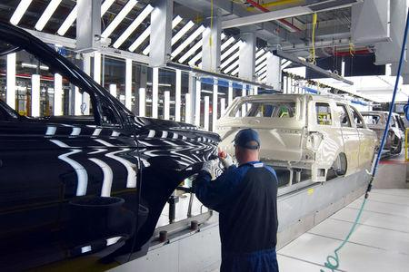 A Ford worker inspects paint work on the body of a Ford Expedition SUV at FordÕs Kentucky Truck Plant in Louisville
