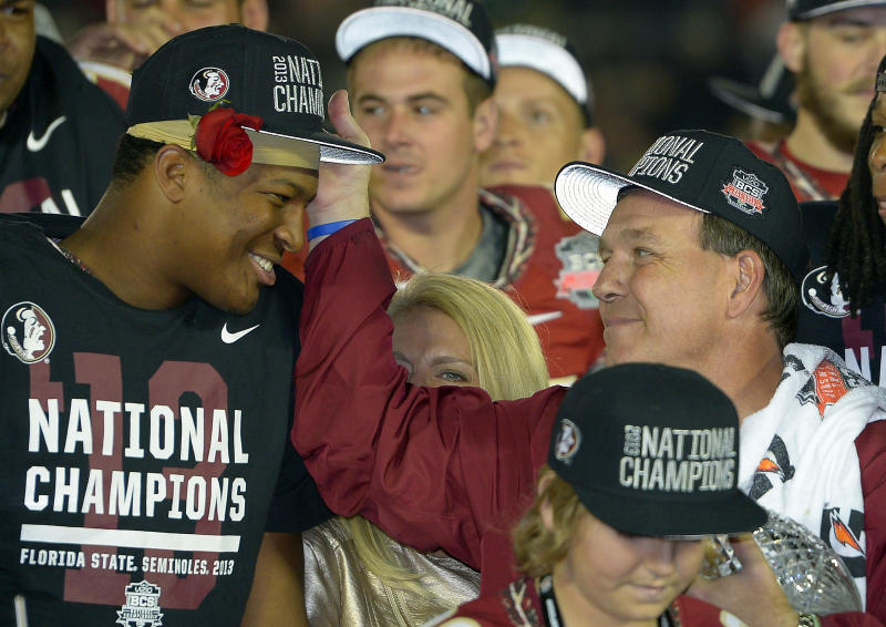 Florida State head coach Jimbo Fisher with Jameis Winston after the NCAA BCS National Championship college football game against Auburn Monday, Jan. 6, 2014, in Pasadena, Calif. Florida State won 34-31. (AP Photo/Mark J. Terrill)