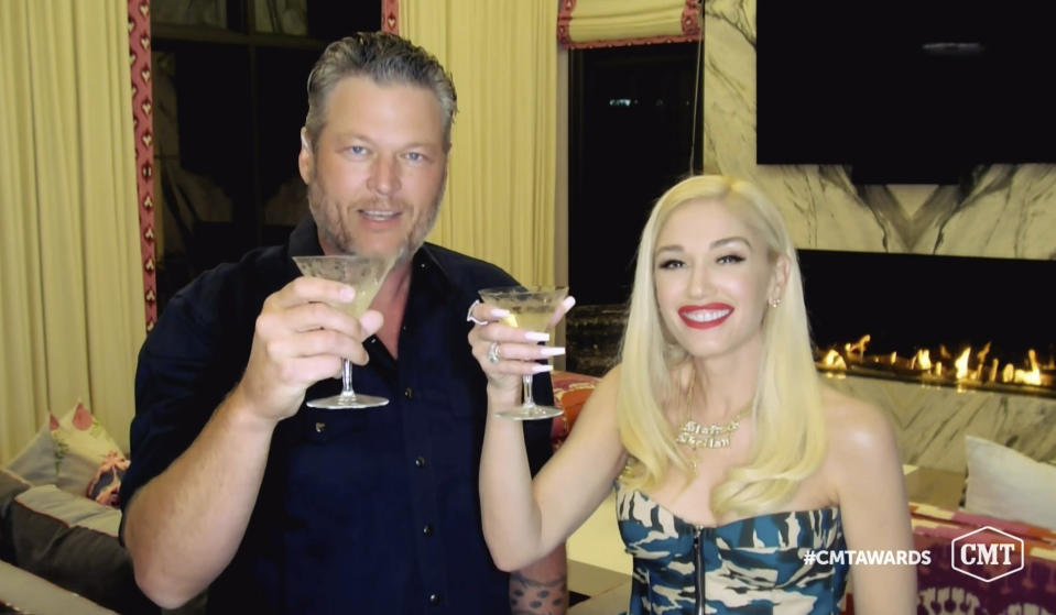 "In this video image provided by CMT, Blake Shelton, left, and Gwen Stefani toast as they accept the collaboration of the year award for ""Nobody But You"" during the Country Music Television awards airing on Wednesday, Oct. 21, 2020. (CMT via AP)"