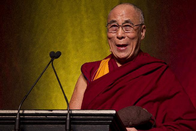 In this photo provided by Brown University, the Dalai Lama delivers the Stephen A. Ogden Jr. '60 Memorial Lecture on International Affairs on Wednesday, Oct. 17, 2012, at the Rhode Island Convention Center in Providence, R.I.  (AP Photo/Brown University, Mike Cohea) MANDATORY CREDIT
