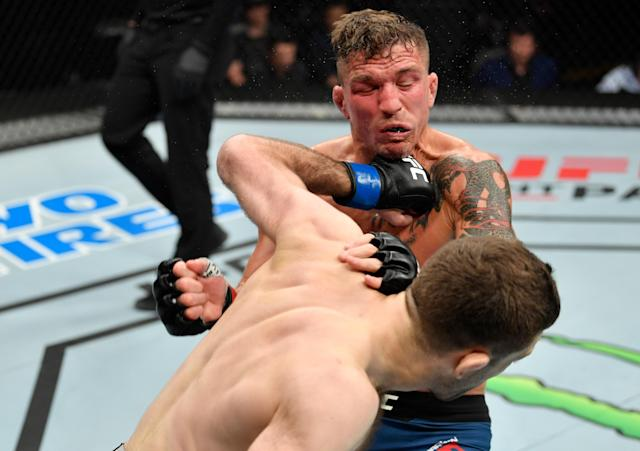 Ryan Hall punches Darren Elkins in their featherweight bout during the UFC Fight Night event at Golden 1 Center on July 13, 2019 in Sacramento, California. (Getty Images)
