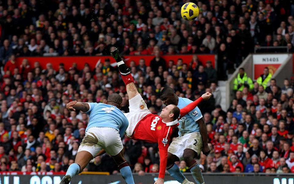 Wayne Rooney of Manchester United scores a goal from an overhead kick during the Barclays Premier League match between Manchester United and Manchester City - Getty Images