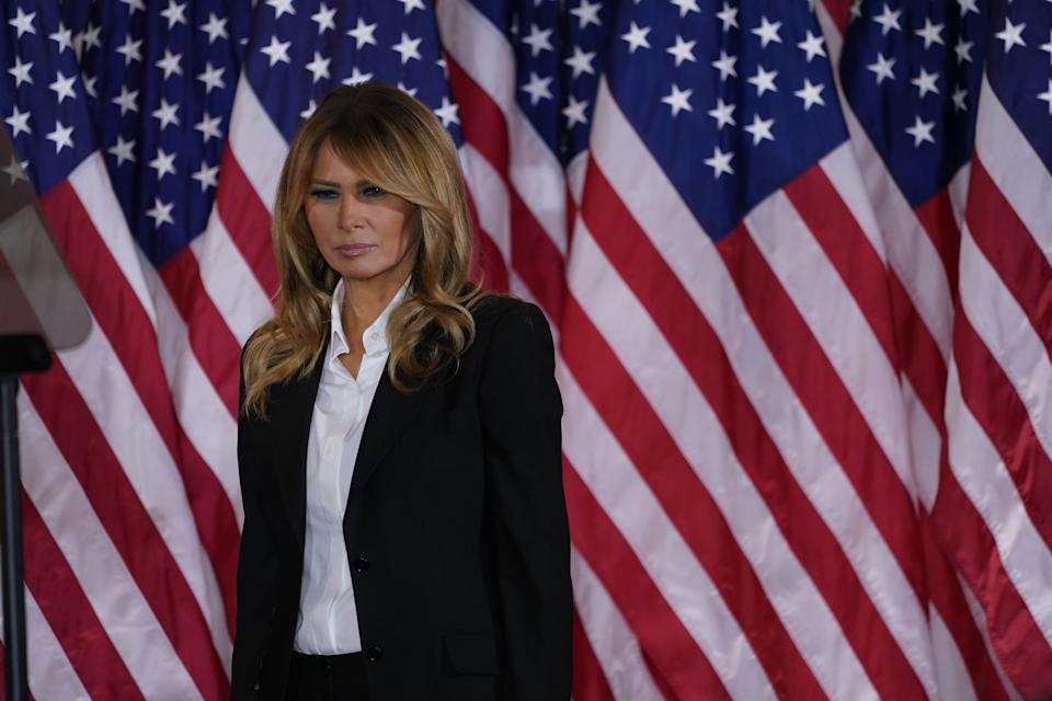 First lady Melania Trump looks on as United States President Donald J. Trump makes a statement to the nation as his supporters look on in the East Room of the White House in Washington, DC on Election Night
