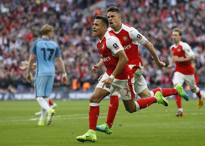 Alexis Sanchez celebrates his goal at Wembley