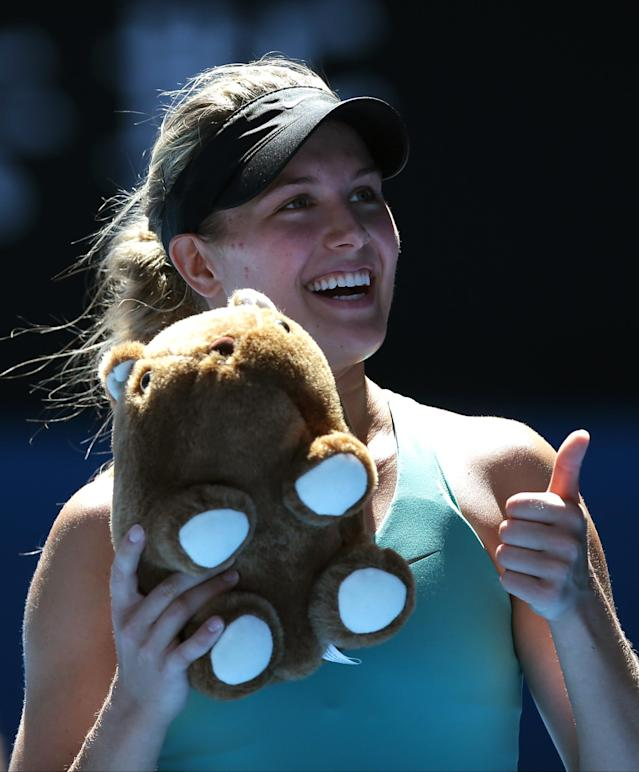 Eugenie Bouchard of Canada, holding stuffed doll of wombat, celebrates after defeating Ana Ivanovic of Serbia during their quarterfinal at the Australian Open tennis championship in Melbourne, Australia, Tuesday, Jan. 21, 2014. (AP Photo/Aaron Favila)