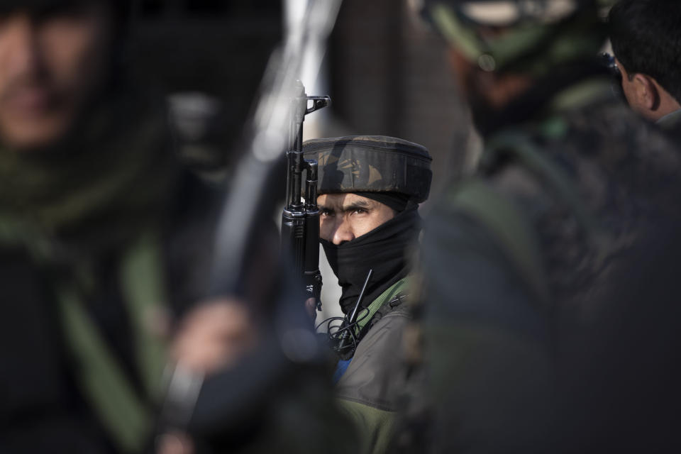 Indian soldier stand guard at the site of an attack on the outskirts of Srinagar, Indian controlled Kashmir, Thursday, March 25, 2021. Rebels fighting against Indian rule in disputed Kashmir Thursday attacked a paramilitary patrol, killing two soldiers and injuring two others, an official said. (AP Photo/Mukhtar Khan)