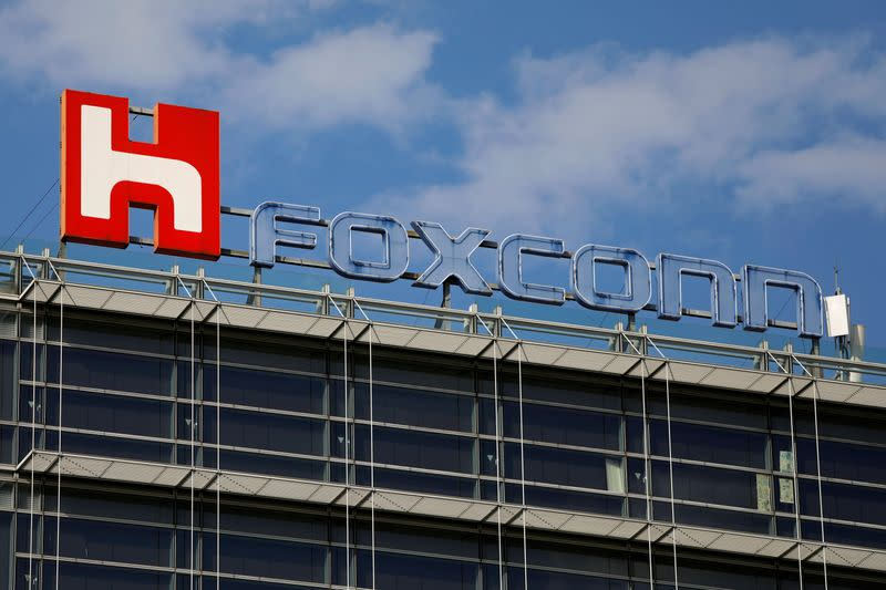 FILE PHOTO: The logo of Foxconn, the trading name of Hon Hai Precision Industry, is seen on top of the company's building in Taipei