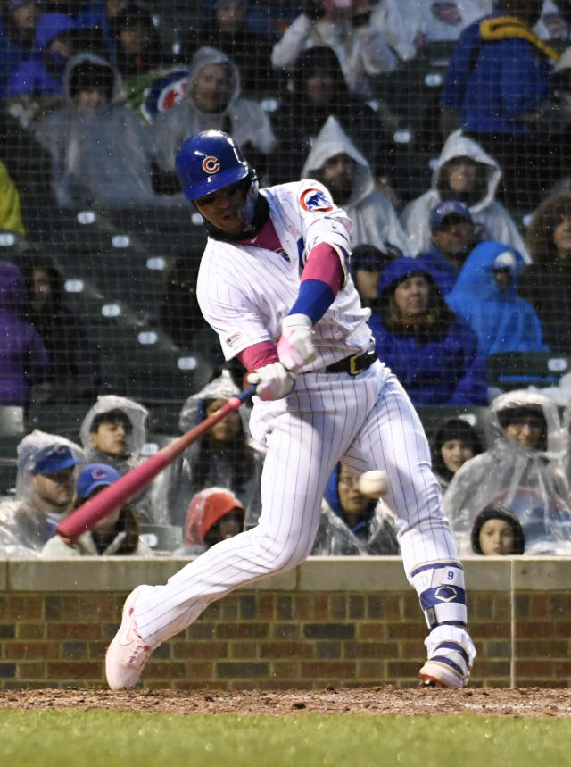 Chicago Cubs' Javier Baez (9) hits a one-run double against the Milwaukee Brewers during the fourth inning of a baseball game, Sunday, May, 12, 2019, in Chicago. (AP Photo/David Banks)
