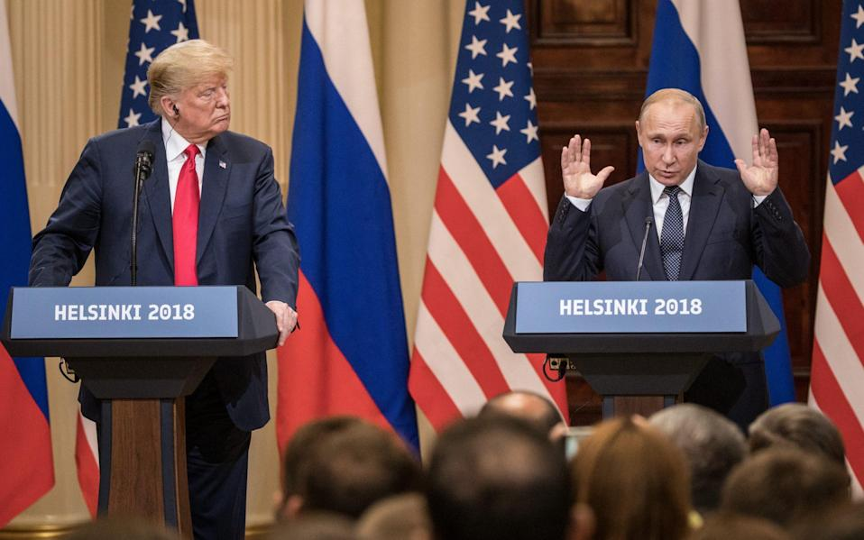 U.S. President Donald Trump (L) and Russian President Vladimir Putin answer questions about the 2016 U.S Election collusion during a joint press conference after their summit on July 16, 2018 in Helsinki, Finland. The two leaders met one-on-one and discussed a range of issues including the 2016 U.S Election collusion - Chris McGrath/Getty Images