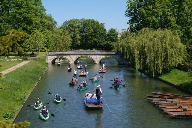Punts and kayaks on the River Cam in Cambridge