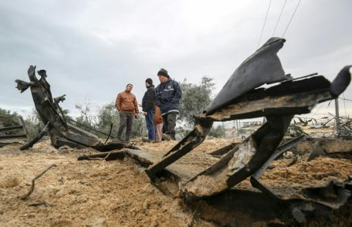 Palestinians inspect the damage from a retaliatory Israeli air strike on the southern Gaza Strip on Friday