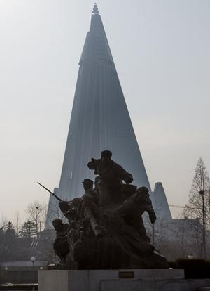 Ryugyong Hotel. The Ryugyong has a rocky history with construction beginning in 1987 and to be completed in 1989. Construction stopped in 1992 with the collapse of the Soviet Union. The building stood as a concrete hulk until 2008 when construction was resumed by an Egyptian company.