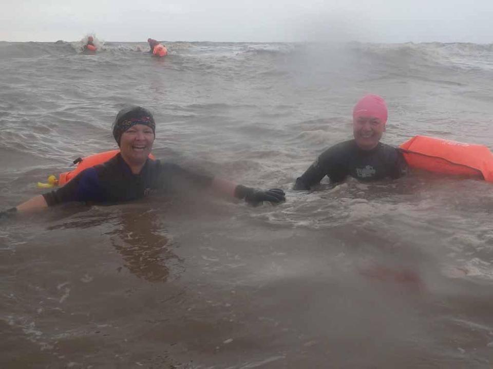 Justine and Sarah wild swimming together (Collect/PA Real Life).