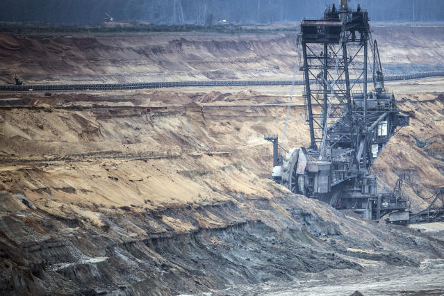 A giant bucket wheel digs for lignite at the Hambach open pit mining near the village Elsdorf, Germany, Wednesday, Jan. 16, 2019. (Federico Gambarini/dpa via AP)