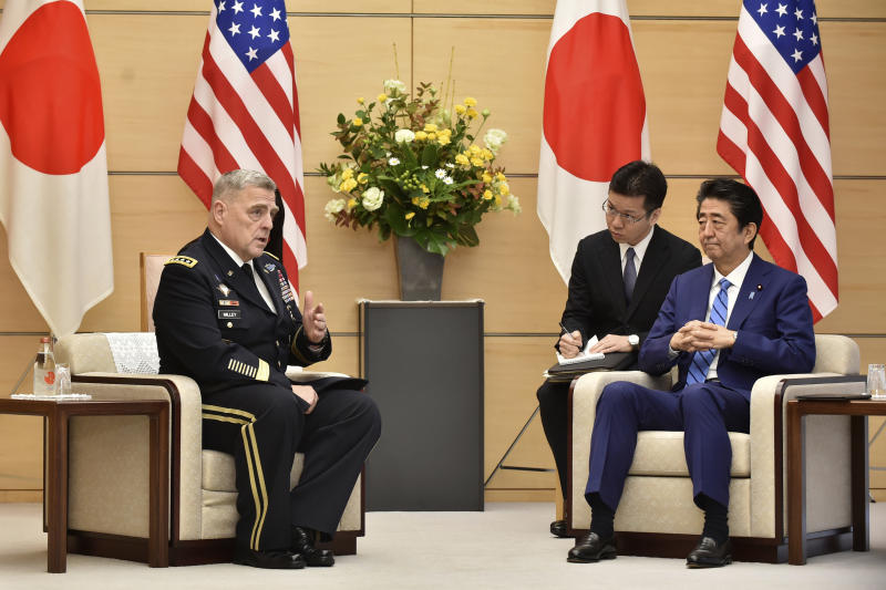 Japan's Prime Minister Shinzo Abe, right, meets with U.S. Chairman of the Joint Chiefs of Staff Gen. Mark Milley, left, prior to their talks at the Abe's office in Tokyo Tuesday, Nov. 12, 2019. (Kazuhiro Nogi/Pool Photo via AP)