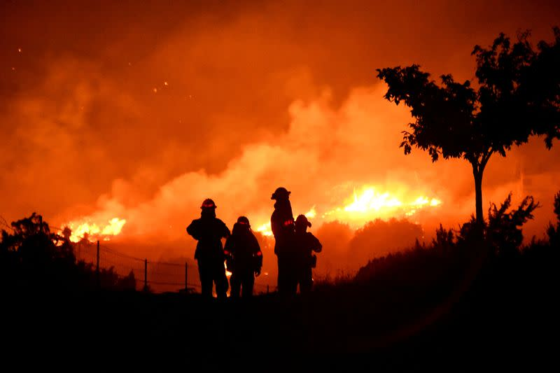 FILE PHOTO: Wildfire in California burns through the night north of Los Angeles