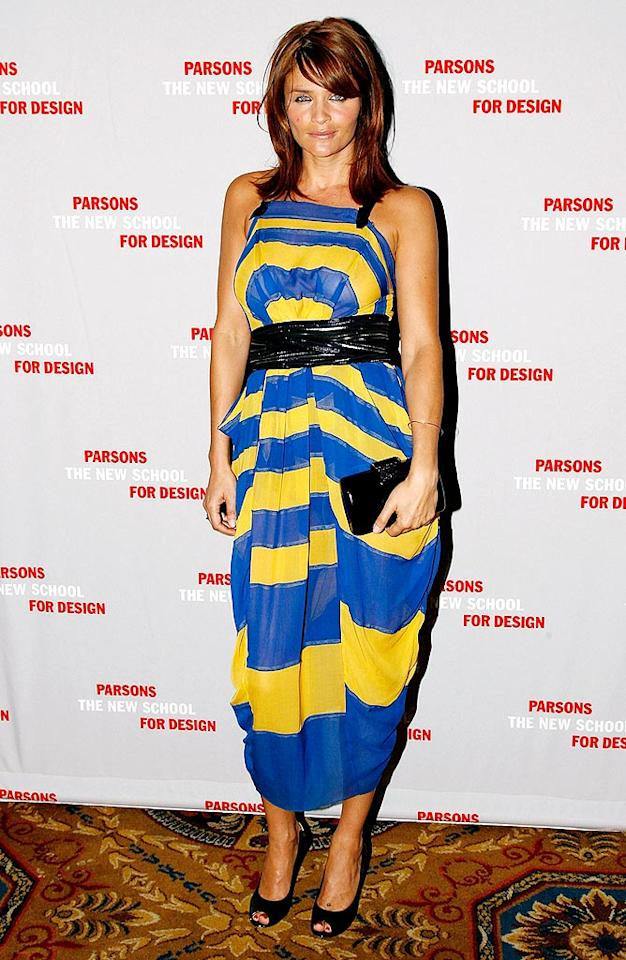 """Helena Christensen added a splash of color to the red carpet with her luscious auburn locks and blue-and-yellow Marc Jacobs draped dress. A matching black clutch, sash, and peep toes completed her look. Joe Kohen/<a href=""""http://www.wireimage.com"""" target=""""new"""">WireImage.com</a> - April 29, 2009"""