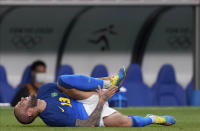 Brazil's Dani Alves reacts after being fouled during a men's soccer match against Saudi Arabia at the 2020 Summer Olympics, Wednesday, July 28, 2021, in Saitama, Japan. (AP Photo/Martin Mejia)