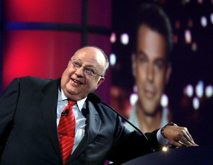 In this July 24, 2006 file photo, Roger Ailes, chairman and chief executive officer of Fox News, listens as anchor Shepard Smith, seen on screens in front and behind him, as Smith talks to the audience via satellite from Israel, at the Summer Television Critics Association Press Tour in Pasadena, Calif. (Photo: Reed Saxon/AP)