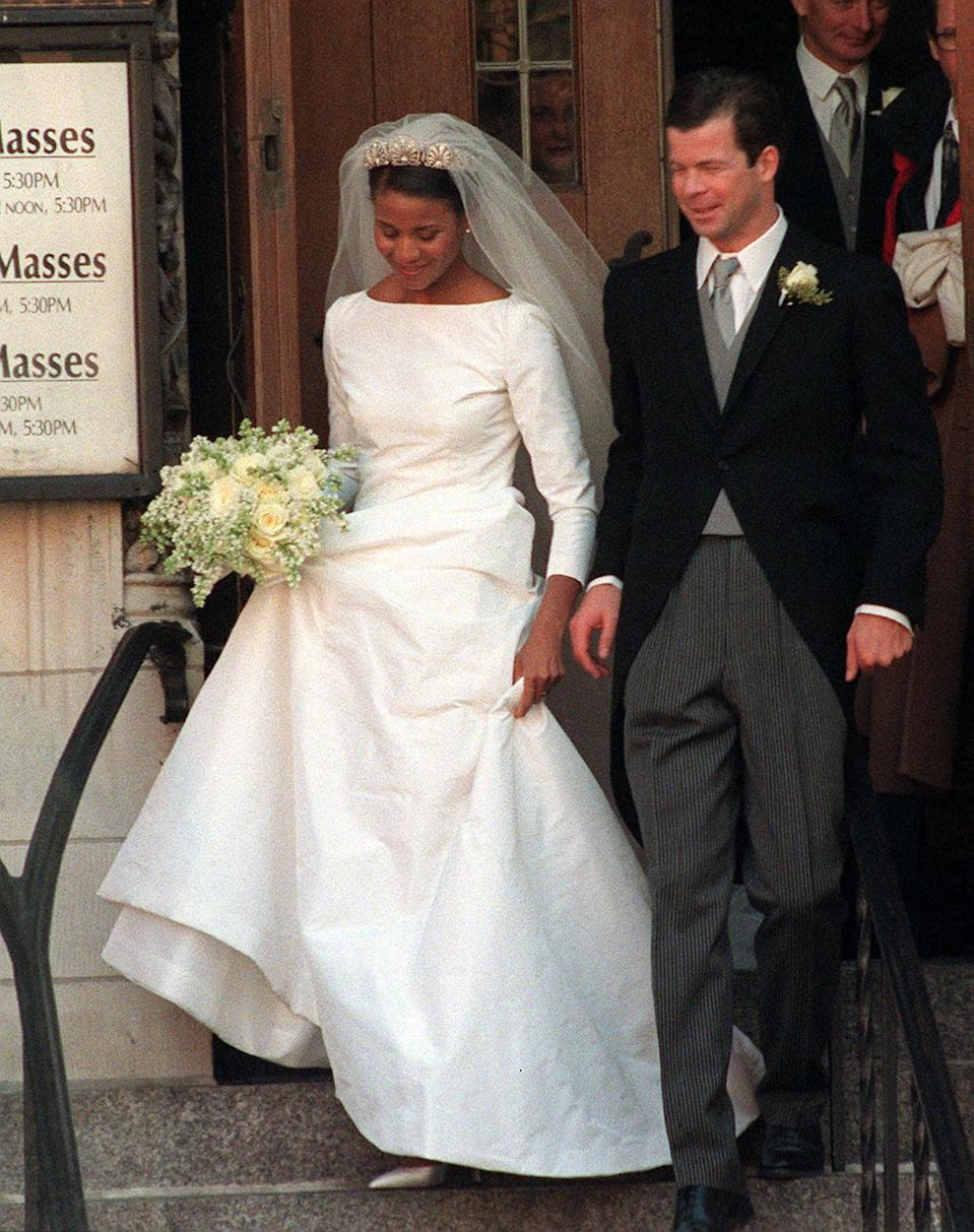 Meghan's dress looks almost identical to the gown Princess Angela of Liechtenstein for her wedding to Prince Maximilian of Liechtenstein in 2000. Photo: AAP