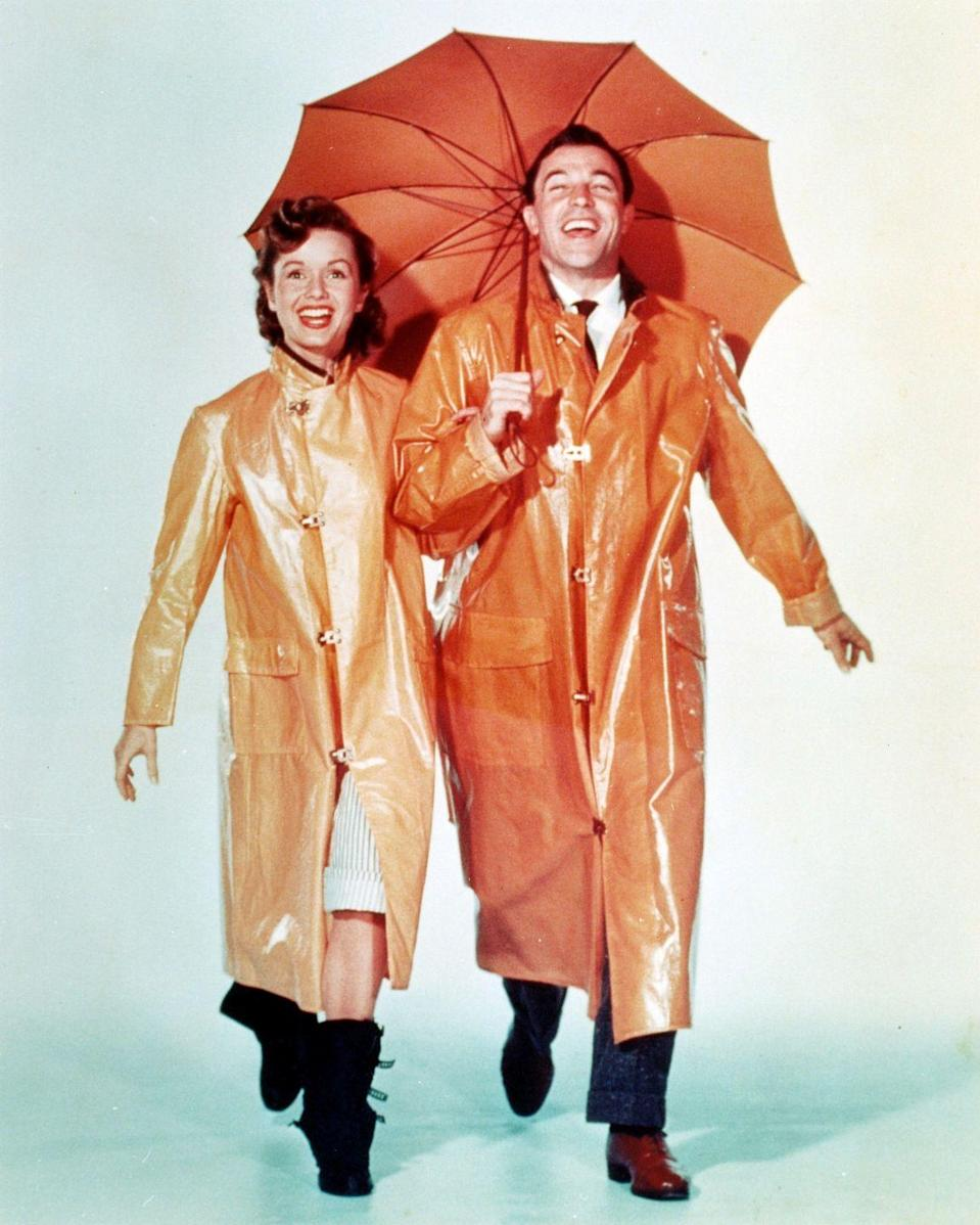 <p>Debbie Reynolds looks like she can brave any storm in her chunky black mid-calf rain boots from <em>Singin' in the Rain</em>.</p>
