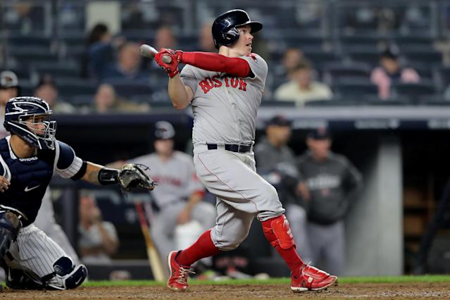 The Boston Red Sox's Brock Holt made history by hitting for the cycle — the first MLB player to do it in the postseason. (Getty Images)