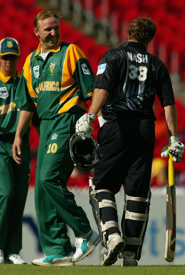 6 Feb 2002:  Allan Donald of South Africa shares a joke with Dion Nash of New Zealand, during the first final of the VB Series, played between New Zealand and South Africa at the Melbourne Cricket Ground, Melbourne, Australia. DIGITAL IMAGE Mandatory Credit: Hamish Blair/Getty Images