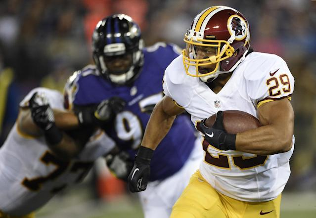 Washington Redskins running back Roy Helu rushes the ball in the first half of an NFL preseason football game against the Baltimore Ravens, Saturday, Aug. 23, 2014, in Baltimore. (AP Photo/Nick Wass)