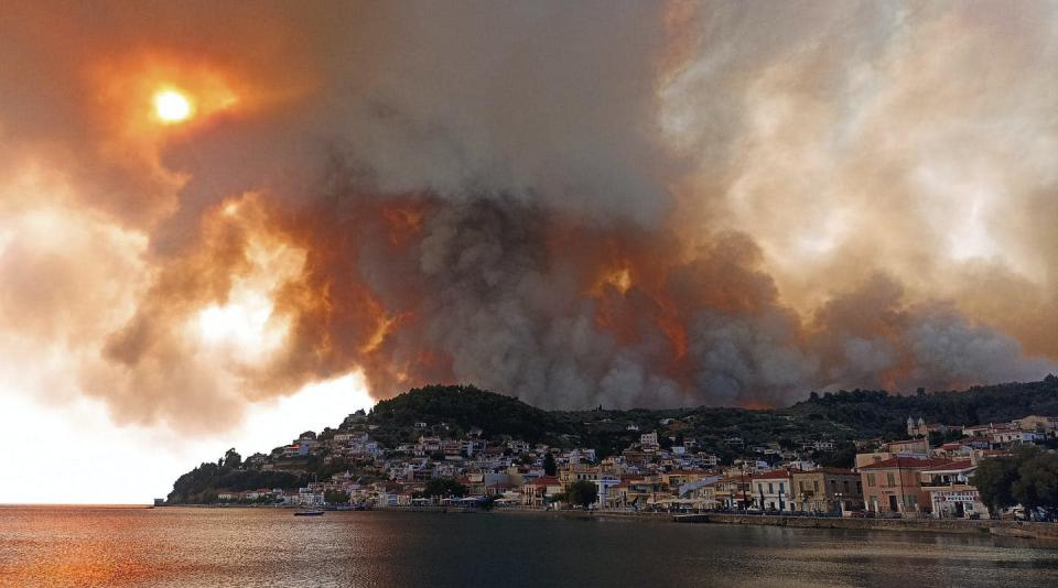 """<span class=""""caption"""">Wildfires burn on the island of Evia, north of Athens, Greece, on Aug. 3, 2021, as the country dealt with the worst heat wave in decades. Temperatures reached 41 C in parts of Athens. </span> <span class=""""attribution""""><span class=""""source"""">(AP Photo/Michael Pappas) </span></span>"""