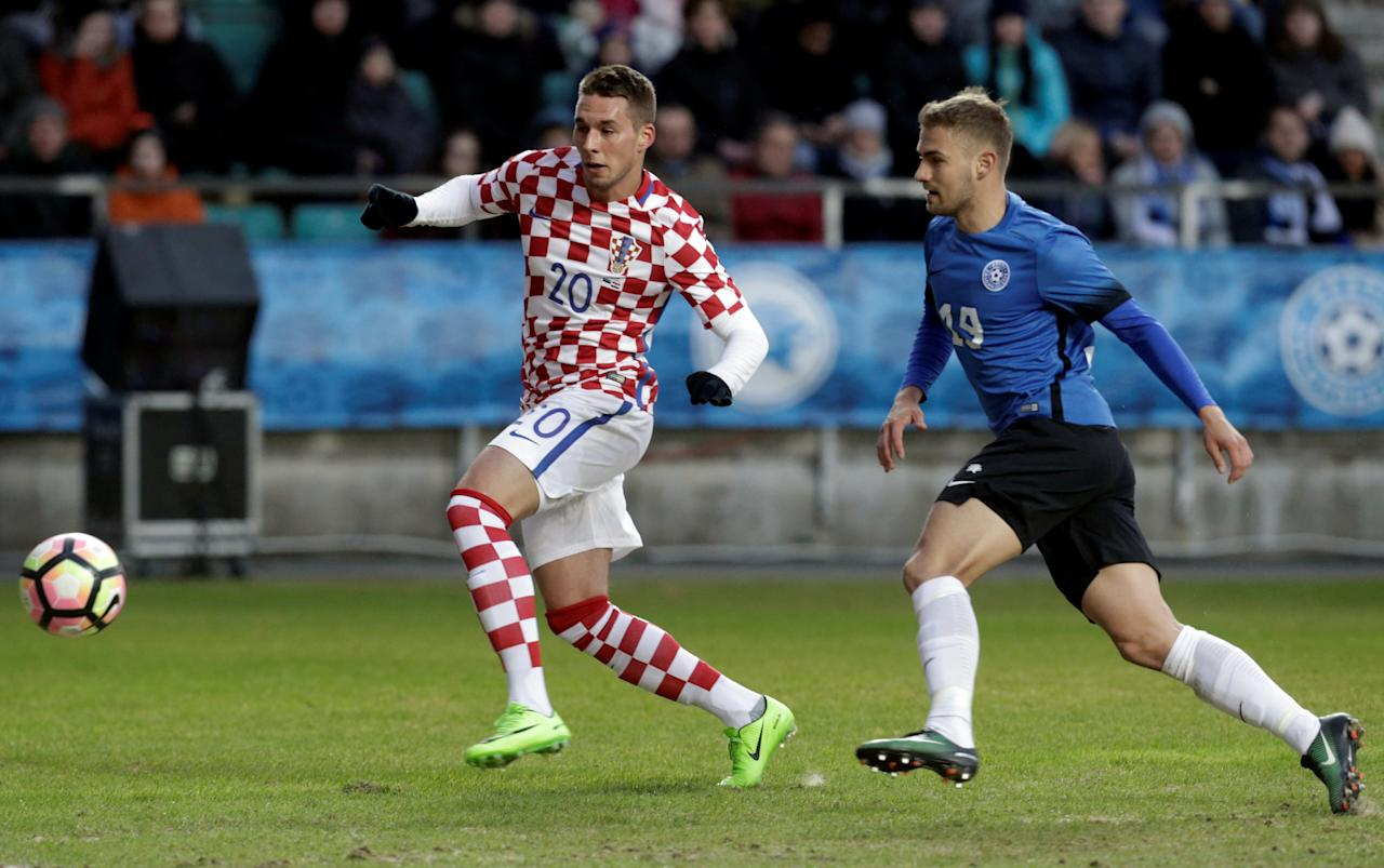 Football Soccer- Estonia v Croatia - International Friendly - A. Le Coq Arena, Tallinn, Estonia - 28/3/17. Marko PJaca of Croatia in action with Ken Kallaste of Estonia. REUTERS/Ints Kalnins