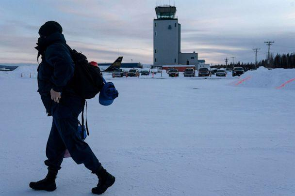 PHOTO: United States Public Health Service nurse, Faith Walsh carries a cooler containing a single vial of Moderna coronavirus disease (COVID-19) vaccine to her flight out of Fairbanks, Alaska, March 31, 2021. (Nathan Howard/Reuters, FILE)