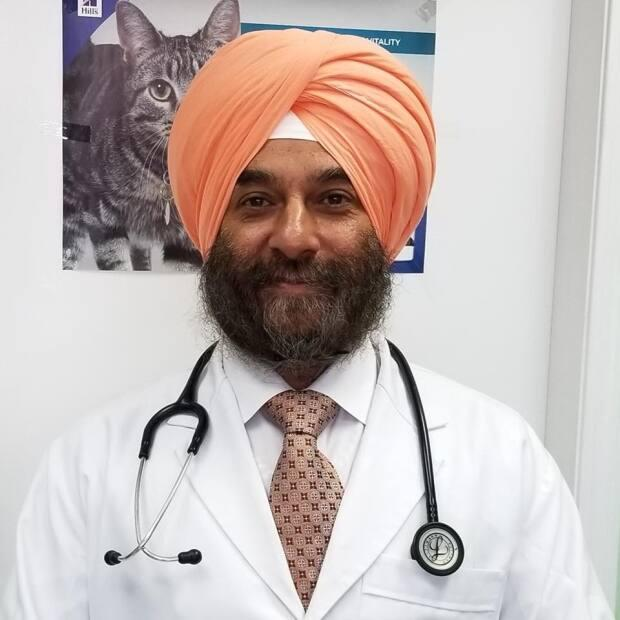 Dr. Bhupinder Johar, owner of the Haney Animal Hospital in Abbotsford, B.C., is the lead complainant in a new discrimination case against the College of Veterinarians of B.C. (Facebook/Haney Animal Hospital - image credit)