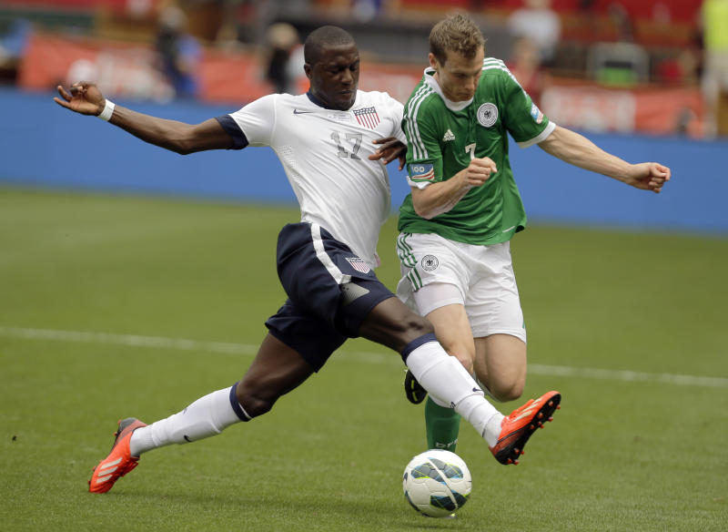 U.S. forward Jozy Altidore (17) and Germany defenseman Marcell Jansen (7) go for the ball during the first half of an international friendly soccer match at RFK Stadium Sunday, June 2, 2013, in Washington. (AP Photo/Alex Brandon)