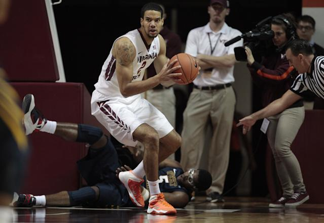 Virginia Tech forward Joey Van Zegeren (2) is called for a foul during the first half of an NCAA college basketball game against West Virginia in Blacksburg, Va., Tuesday, Nov. 12, 2013. At rear on the floor is West Virginia's Devin Williams. (AP Photo/The Roanoke Times, Daniel Lin)