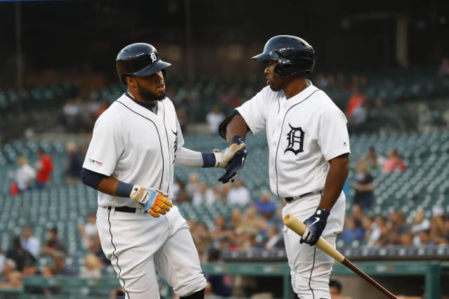 Detroit Tigers' Dawel Lugo, left, celebrates with Christin Stewart after scoring against the Minnesota Twins during the first inning of a baseball game in Detroit, Tuesday, Sept. 24, 2019. (AP Photo/Paul Sancya)