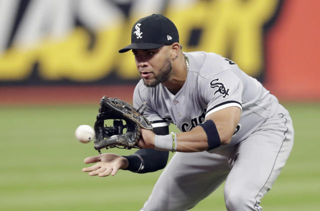 FILE - In this Sept. 19, 2018, file photo, Chicago White Sox's Yoan Moncada fields a ball hit by Cleveland Indians' Melky Cabrera during the fourth inning of a baseball game in Cleveland. Cabrera was out on the play. Moncada and pitchers such as Lucas Giolito and Michael Kopech have shown potential in the majors. (AP Photo/Tony Dejak, File)