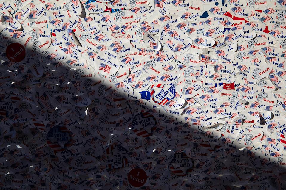 """I voted"" stickers collected by Home Slice Pizza, which offered a free slice of pizza to anyone who showed their sticker, in Austin, Texas, Oct. 31, 2020. (Tamir Kalifa/The New York Times)"