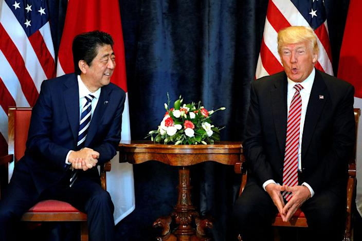 <p>U.S. President Donald Trump (R) speaks beside Japan's Prime Minister Shinzo Abe during a bilateral meeting at the G7 summit in Taormina, Sicily, (Photo: Jonathan Ernst/Reuters) </p>