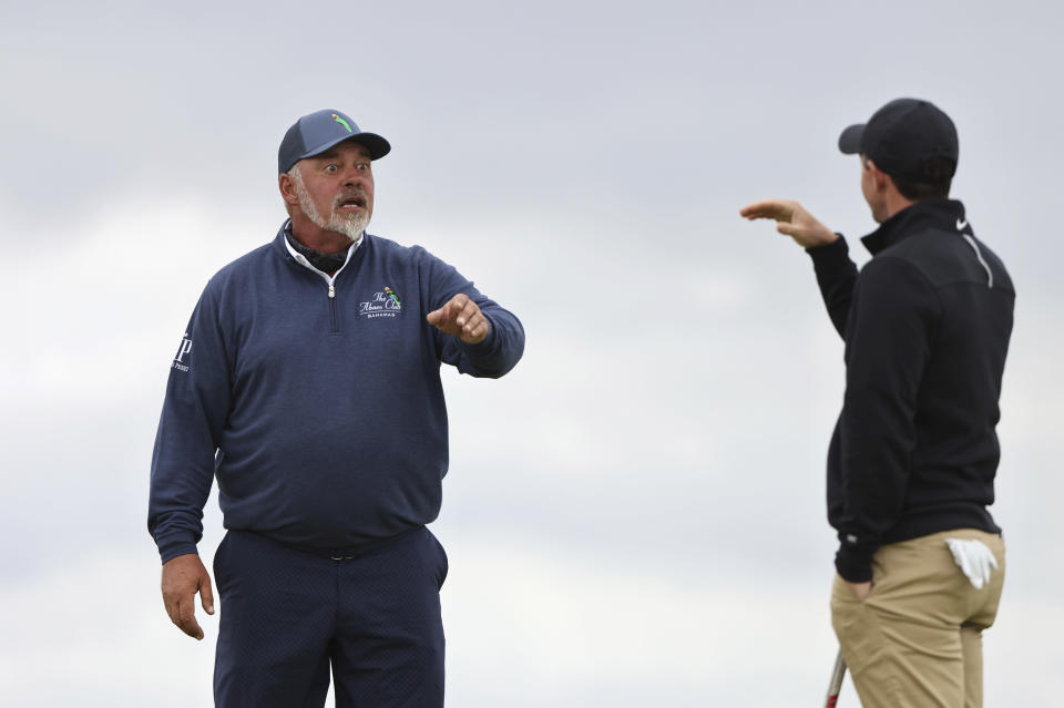 Northern Ireland's Rory McIlroy, right talks to Northern Ireland's Darren Clarke on the 10th hole during a practice round for the British Open Golf Championship at Royal St George's golf course Sandwich, England, Wednesday, July 14, 2021. The Open starts Thursday, July, 15. (AP Photo/Ian Walton)