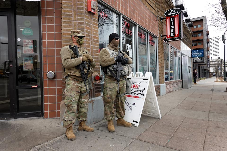 MINNEAPOLIS, MINNESOTA - APRIL 15: National guard soldier are posted on a street corner near downtown as the city prepares for reaction to the verdict in the Derek Chauvin trial on April 15, 2021 in Minneapolis, Minnesota. Chauvin, a former Minneapolis police officer, is standing trial for murder in the death of George Floyd.   (Photo by Scott Olson/Getty Images)