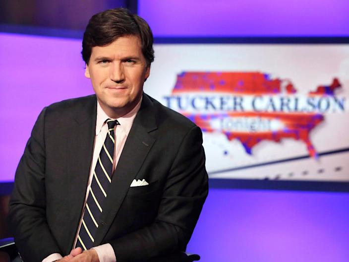 <p>Fox News host Tucker Carlson accused Democrats of 'replacing' American voters with immigrants</p> (AP)