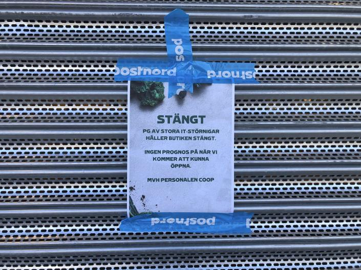 """A sign that reads: """"Coop Forum supermarket in Vastberga is closed due to IT disturbances, no prognosis as to when we will open again"""", on a closed Coop supermarket store in the suburb of Vastberga, Stockholm, Sweden, Saturday July 3, 2021. Cybersecurity teams worked feverishly Sunday July 4, 2021, to stem the impact of the single biggest global ransomware attack on record, with some details emerging about how the Russia-linked gang responsible breached the company whose software was the conduit. The Swedish grocery chain Coop said most of its 800 stores would be closed for a second day Sunday because their cash register software supplier was crippled. (Jonas Ekstromer/TT via AP, File)"""