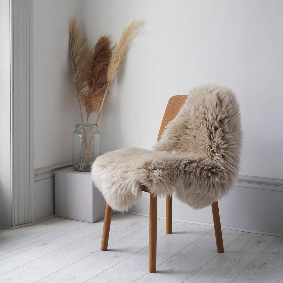 <p>It doesn't get any comfier than this <span>Surrey Style Interiors Sheepskin Rug</span> ($72). It will feel soft and plush under your feet and also double as a decor piece for interior photos.</p>