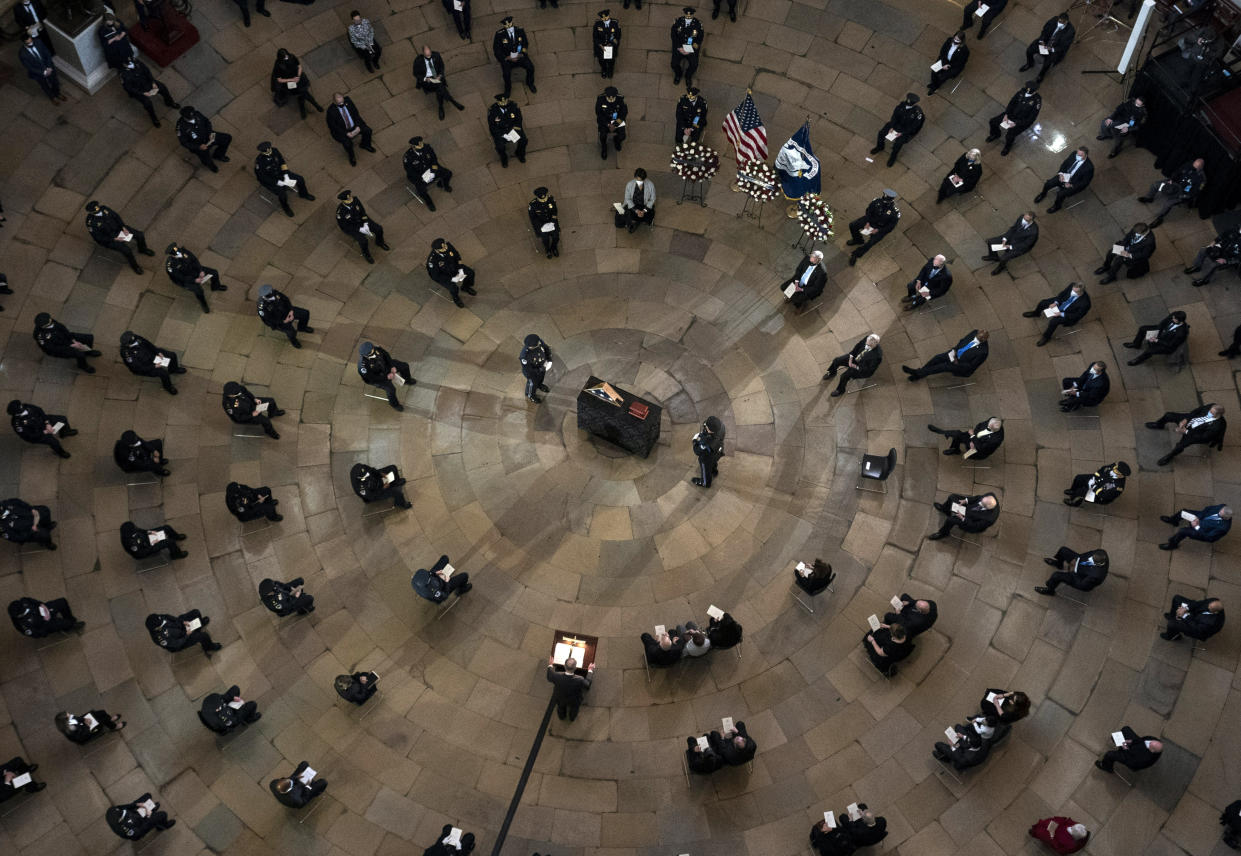 Senate Majority Leader Chuck Schumer of N.Y., speaks during a ceremony memorializing U.S. Capitol Police officer Brian Sicknick, as an urn with his cremated remains lies in honor on a black-draped table at the center of the Capitol Rotunda, Wednesday, Feb. 3, 2021, in Washington. (Kevin Dietsch/Pool via AP)