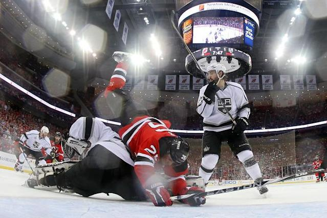 NEWARK, NJ - JUNE 02: Patrik Elias #26 of the New Jersey Devils collides with Jonathan Quick #32 of the Los Angeles Kings as Drew Doughty #8 looks on during Game Two of the 2012 NHL Stanley Cup Final at the Prudential Center on June 2, 2012 in Newark, New Jersey. (Photo by Bruce Bennett/Getty Images)