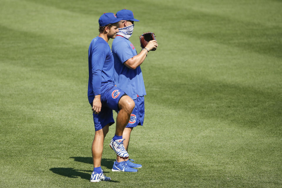 Chicago Cubs first baseman Anthony Rizzo, left, stands next to manager David Ross, right, during baseball practice at Wrigley Field, Sunday, July 5, 2020, in Chicago. (AP Photo/Kamil Krzaczynski)