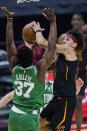 Cleveland Cavaliers' Brodric Thomas, right, drives to the basket against Boston Celtics' Semi Ojeleye during the second half of an NBA basketball game Wednesday, May 12, 2021, in Cleveland. (AP Photo/Tony Dejak)