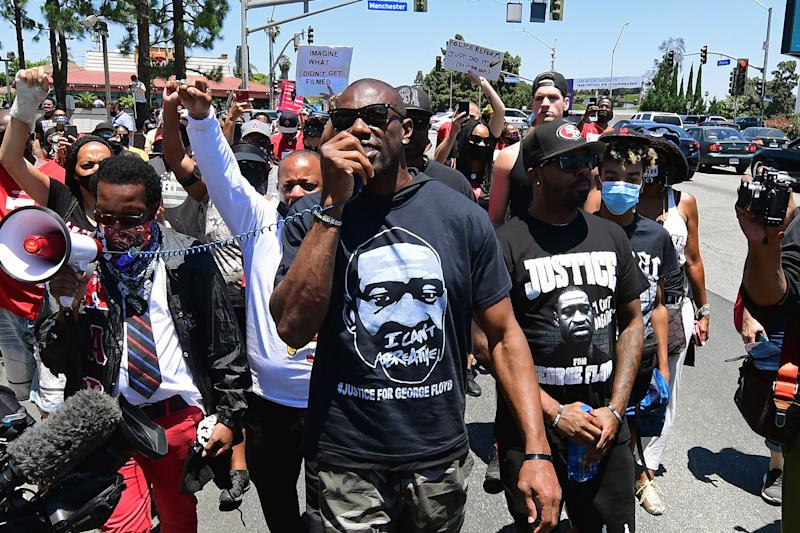 Former NFL wide receiver Terrell Owens leads a protest march in support of quarterback Colin Kaepernick in Inglewood, California, on June 11, 2020.