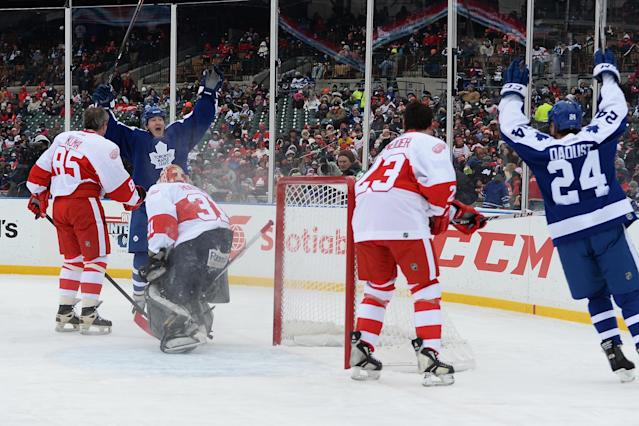 DETROIT, MI - DECEMBER 31: Stew Gavin #9 of the Toronto Maple Leafs celebrates his first period goal against the Detroit Red Wings during the 2013 Hockeytown Winter Festival Alumni Showdown on December 31, 2013 at Comerica Park in Detroit, Michigan. (Photo by Jamie Sabau/Getty Images)