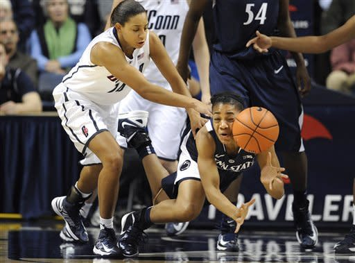 Penn State's Ariel Edwards, right, dives for the ball while pressured by Connecticut's Bria Hartley, left, during the first half of an NCAA college basketball game in Storrs, Conn., Thursday, Dec. 6, 2012. (AP Photo/Jessica Hill)